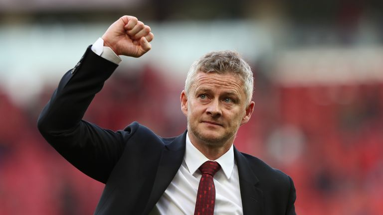 Ole Gunnar Solskjaer salutes the Old Trafford fans after the victory