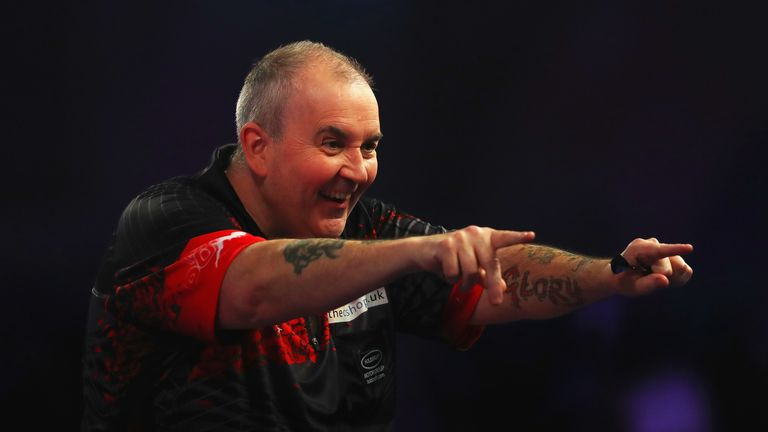 Phil Taylor of England celebrates after scoring 180 during the PDC World Darts Championship final against Rob Cross of England on Day Fifteen at the 2018 William Hill PDC World Darts Championships at Alexandra Palace on January 1, 2018 in London, England.