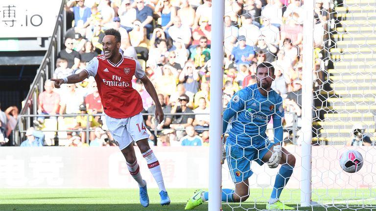 Pierre-Emerick Aubameyang celebrates his second goal away to Watford