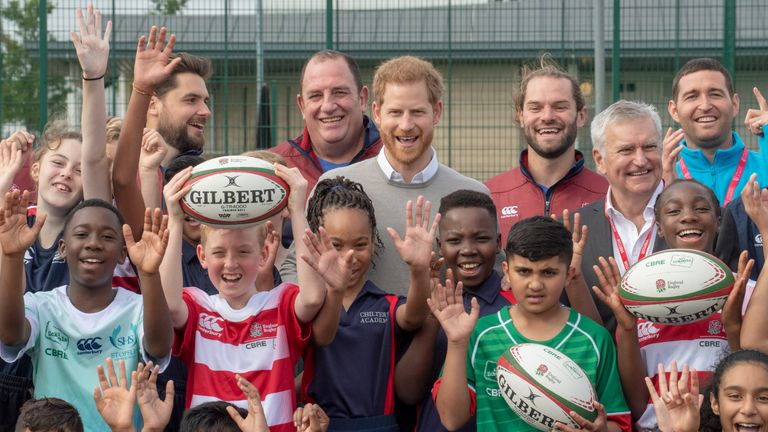 The Duke of Sussex poses for a photo during his visit to Lealands High School in Luton