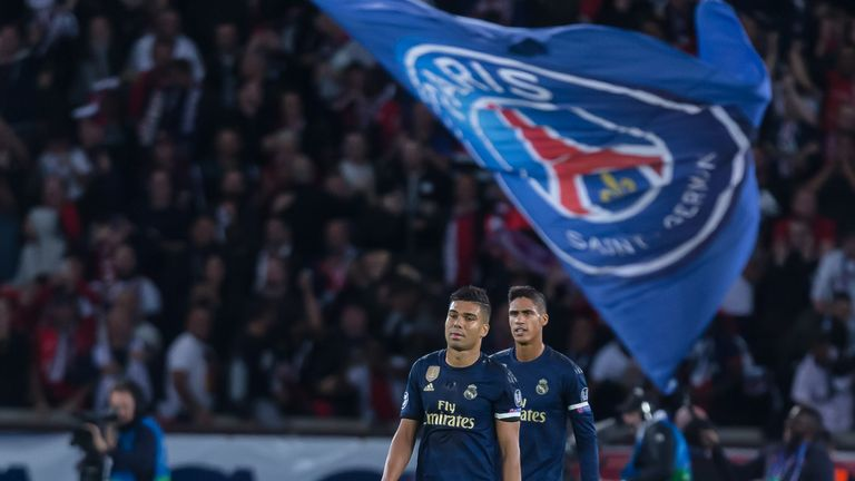 Real Madrid players stand dejected at the Parc des Princes