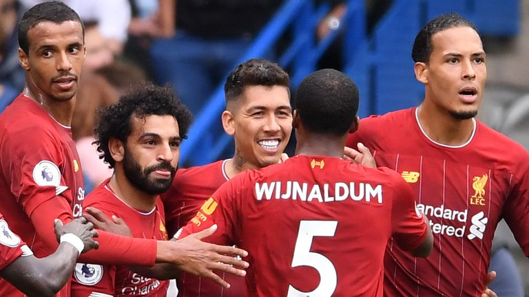 Team-mates congratulate Roberto Firmino after he doubles Liverpool's lead
