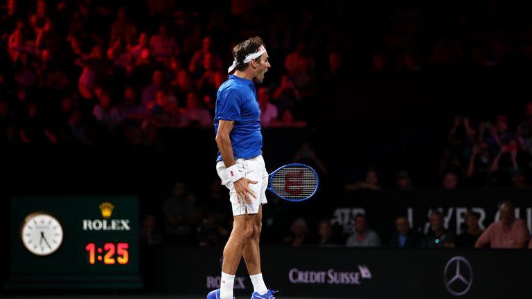 Roger Federer kept Europe alive with a huge win over Team World's John Isner