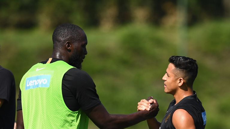 Romelu Lukaku greets Alexis Sanchez during an Inter Milan training session