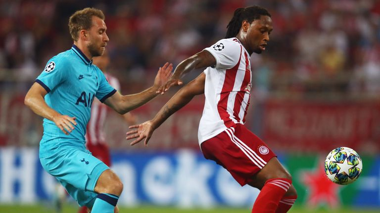 Ruben Semedo of Olympiakos is closed down by Christian Eriksen of Tottenham Hotspur during the UEFA Champions League group B match
