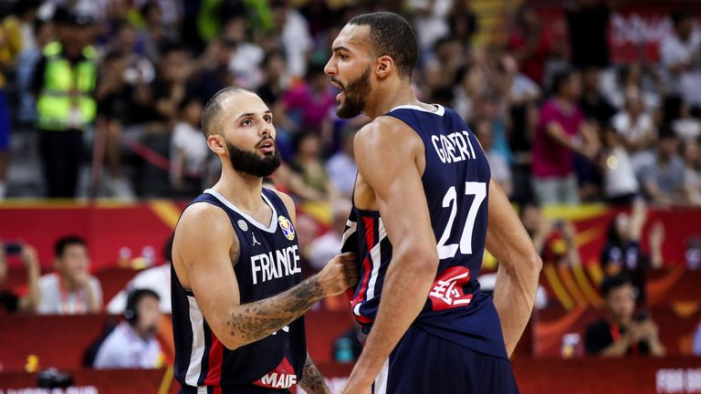 Rudy Gobert of France celebrates the victory with teammate Evan Fournier after the quarter final of 2019 FIBA World Cup between USA and France