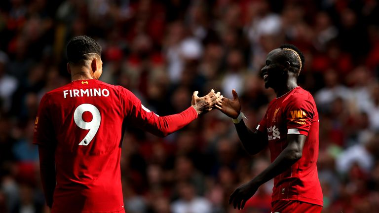 Sadio Mane celebrates with Roberto Firmino after he scores Liverpool's second goal