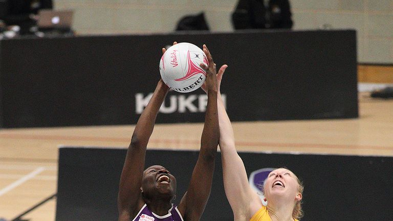 May (r) challenges Peace Proscovia for the ball