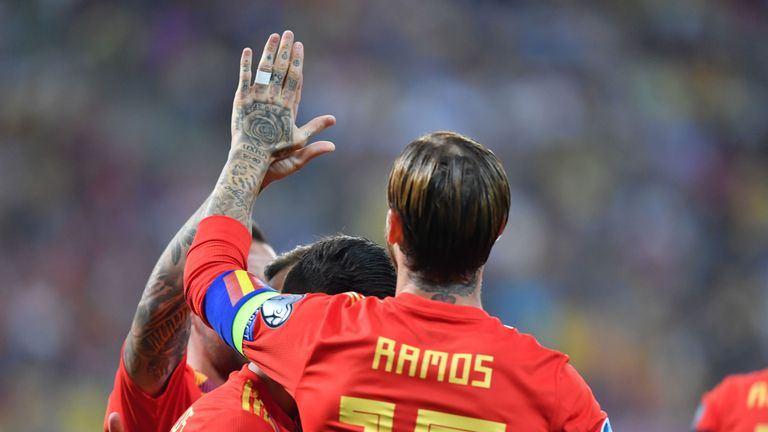 Spain captain Sergio Ramos is congratulated after giving his team the lead vs  Romania