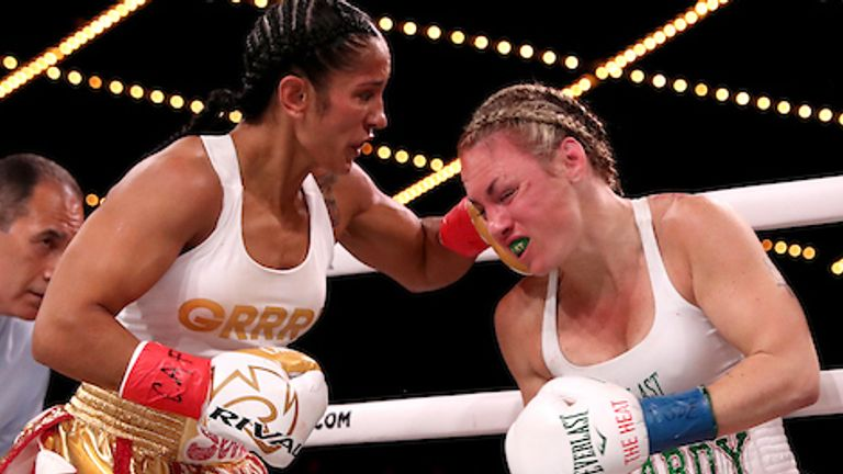 September 13, 2019; New York, NY, USA; WBO featherweight champion Heather Hardy and Amanda Serrano during their bout at the Hulu Theater at Madison Square Garden. Mandatory Credit: Ed Mulholland/Matchroom Boxing USA