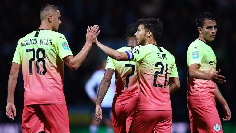 Taylor Harwood-Bellis celebrates with David Silva after Man City's third goal