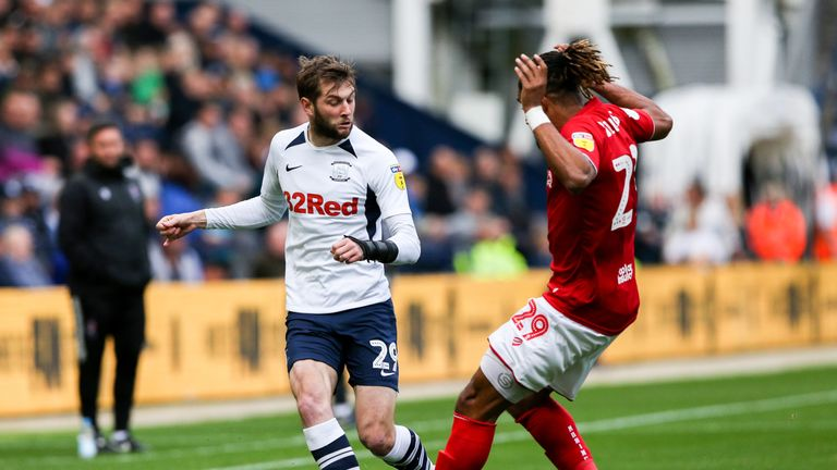Preston North End's Tom Barkhuizen and Bristol City's Ashley Williams in action at Deepdale
