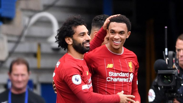 Trent Alexander-Arnold is congratulated by Mohamed Salah