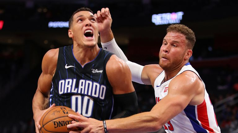 Aaron Gordon attacks the basket against Blake Griffin