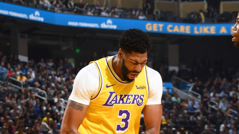 Anthony Davis celebrates his first Lakers basket