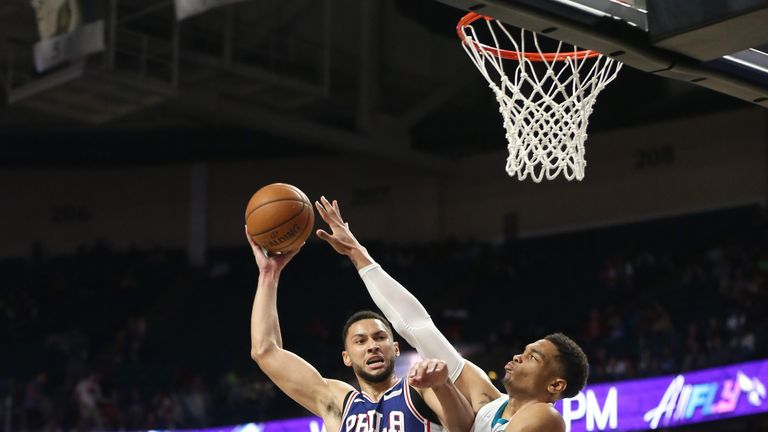 Ben Simmons attacks the basket against the Charlotte Hornets