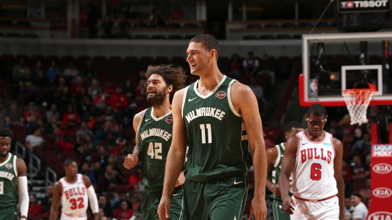 Brook Lopez and brother Robin on court during the Milwaukee Bucks' preseason opener in Chicago