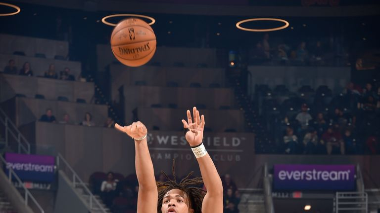 Carsen Edwards launches a three-pointer against the Cleveland Cavaliers