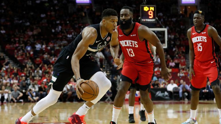 Giannis Antetokounmpo drives by James Harden along the basline