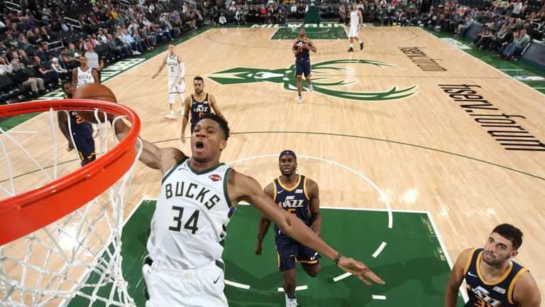 Giannis Antetokounmpo rocks the rim in Milwaukee's preseason win over the Utah Jazz