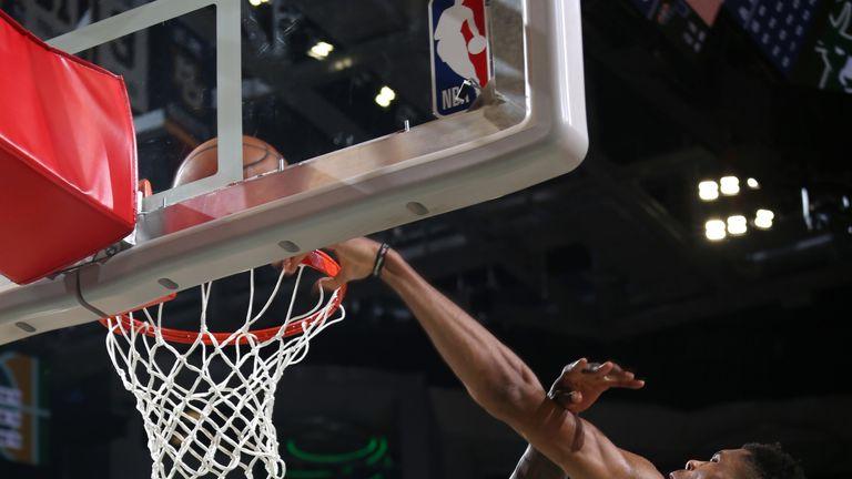 Giannis Antetokounmpo throws down a dunk against the Utah Jazz