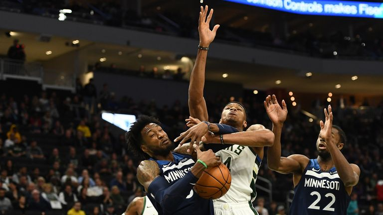 Giannis Antetokounmpo battles for a rebound against the Timberwolves