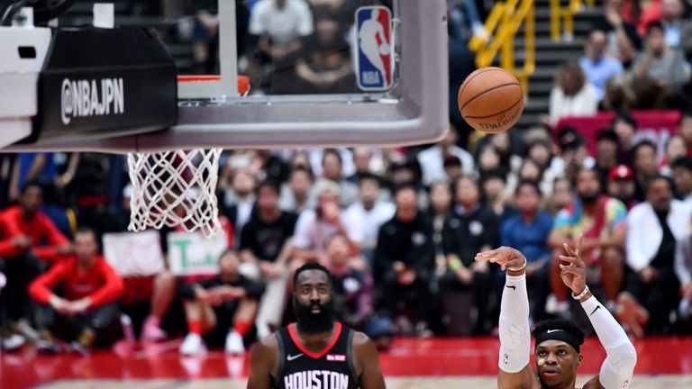 James Harden watches Russell Westbrook shoot a free throw against Toronto