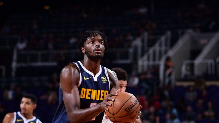Jerami Grant shoots a free throw against Phoenix