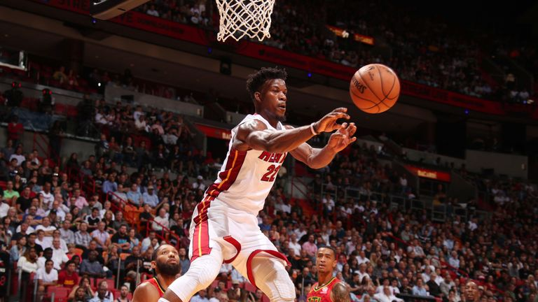 Jimmy Butler throws a pass during his Miami debut