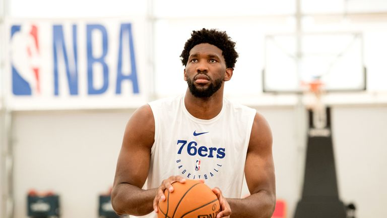 Joel Embiid shoots a free throw during a Sixers' practice