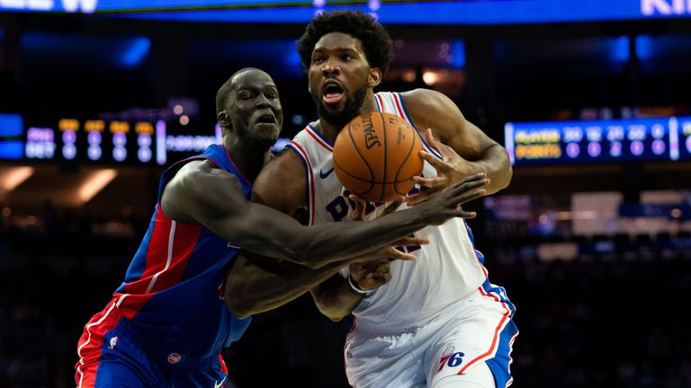 Joel Embiid drives to the basket against Detroit