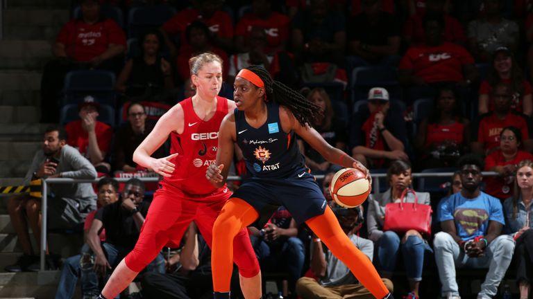Jonquel Jones backs down Emma Meesseman in the post in Game 2 of the WNBA Finals