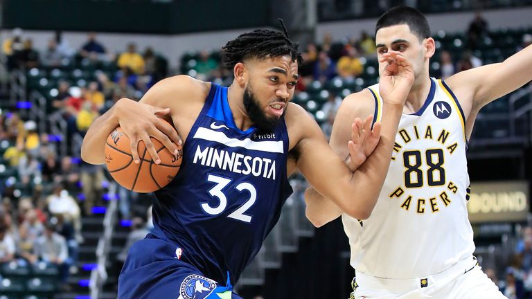 Karl-Anthony Towns drives at the Pacers' defense