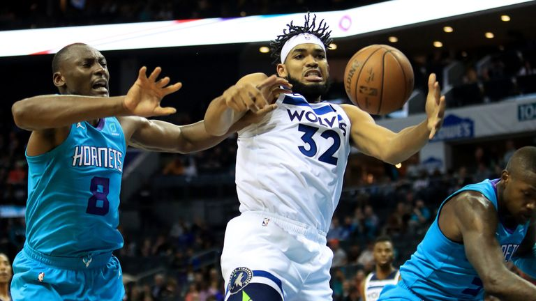 Karl-Anthony Towns battles for a rebound against Charlotte