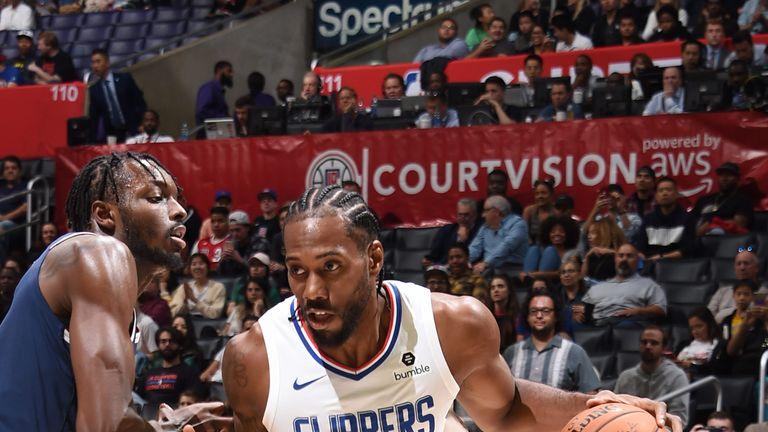 Kawhi Leonard drives during his Clippers preseason debut
