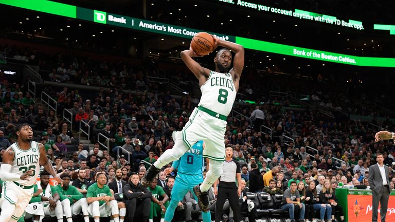 Kemba Walker goes airborne to throw a pass in the Celtics' preseason win over the Hornets