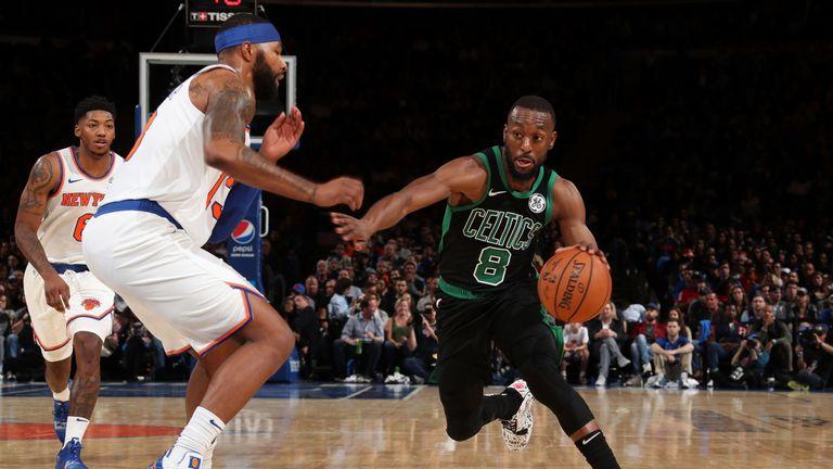 Kemba Walker drives at the Knicks defense