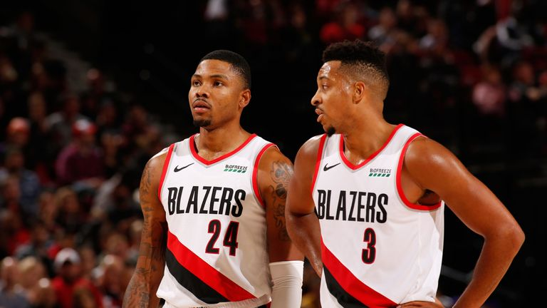 Kent Bazemore shares a word with team-mate CJ McCollum