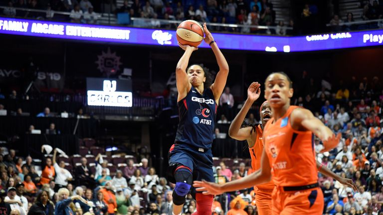 Kristi Toliver lofts a floater over the Connecticut defense in Game 3 of the WNBA Finals