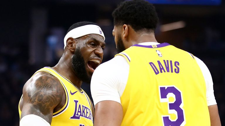 LeBron James and Anthony Davis celebrate after a Lakers basket against Golden State