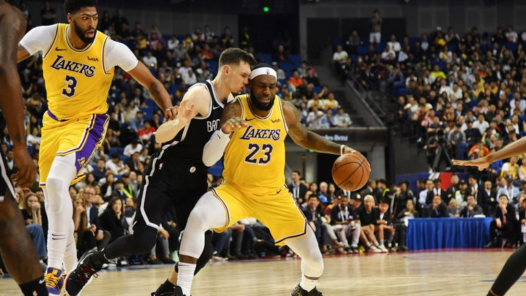 LeBron James is guarded by Rodions Kurucs