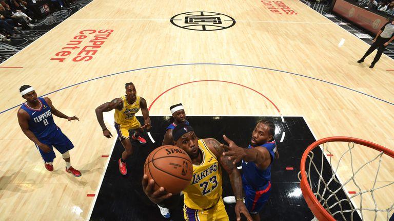 LeBron James scores at the rim