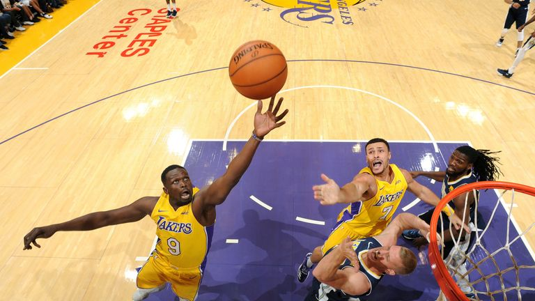 Luol Deng corrals a rebound for the Los Angeles Lakers