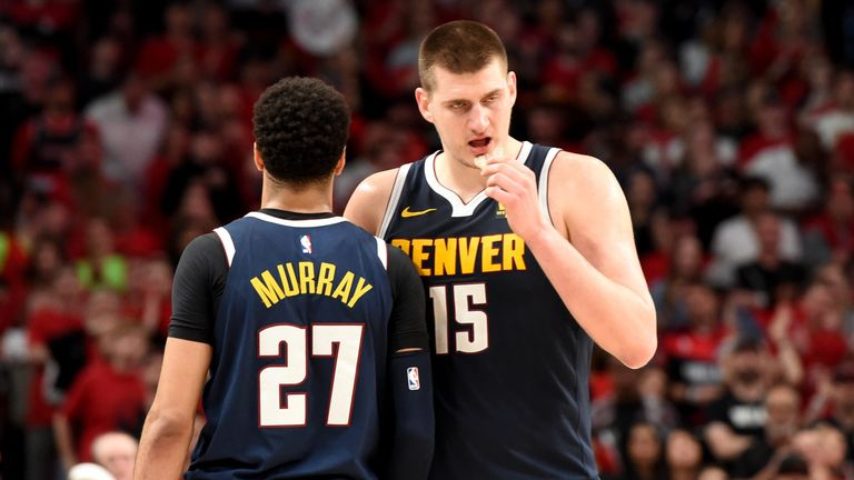 Nikola Jokic and Jamal Murray share a word during a Nuggets preseason game