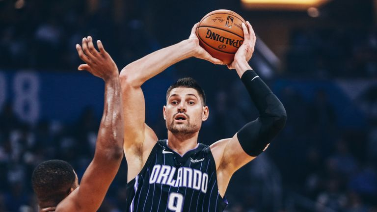 Nikola Vucevic looks to pass against the Cleveland Cavaliers