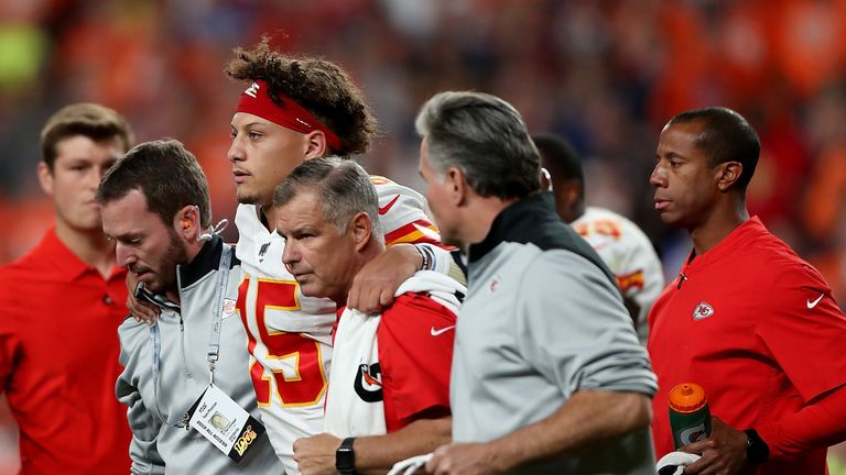 Chiefs quarterback Patrick Mahomes is helped from the field