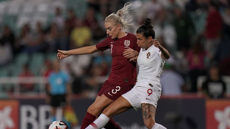 Alex Greenwood and Ana Borges battle for the ball