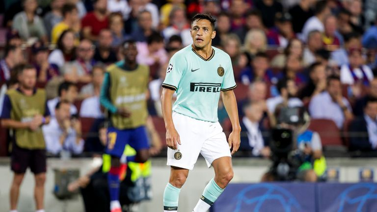 Alexis Sanchez in action for Inter Milan against Barcelona
