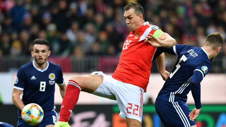 Artem Dzyuba prods in his second during a fine performance for Russia