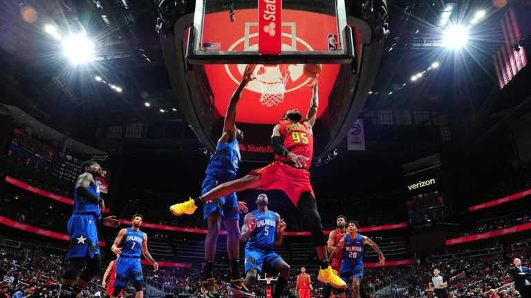 DeAndre' Bembry of the Atlanta Hawks drives to the basket against the Orlando Magic
